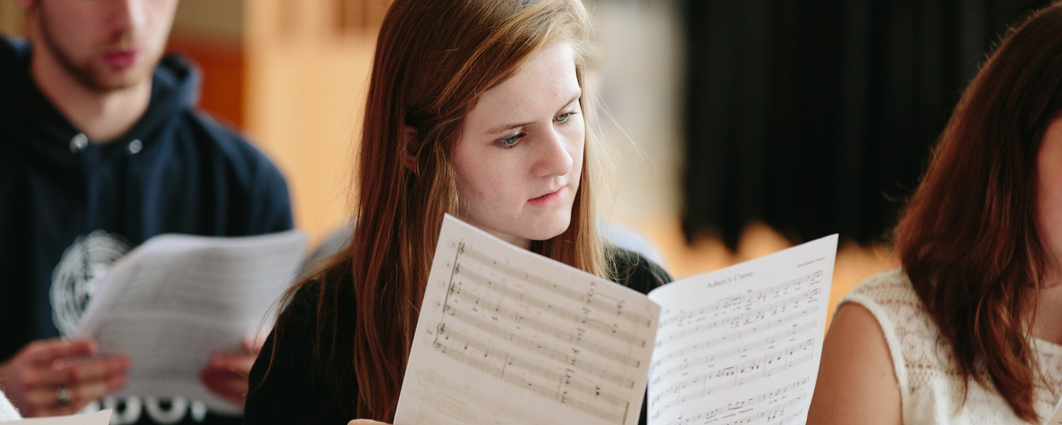 Student looking over sheet music