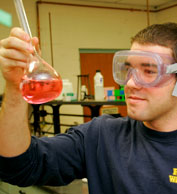 Student holding a vial of chemicals
