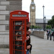4 people in London phone booth near Big Ben