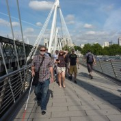 Prof Norm Jones leading group on Embankment bridge