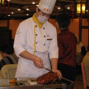 Chinese chef preparing duck