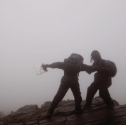 Two students in a storm on a mountain