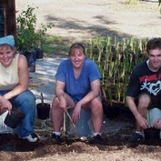Members of the 2002 trip propagating plants