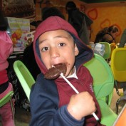 Child eating a chocolate popsicle