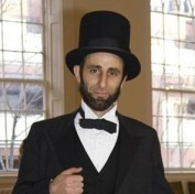 John Sarrouf as Abraham Lincoln