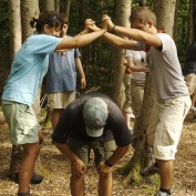 Students complete low ropes course element