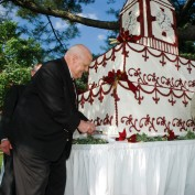 Ken Olsen cutting the cake at groundbreaking ceremony