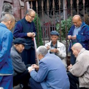 Men gathering to play cards