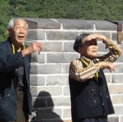 Tourists in awe of the Great Wall of China