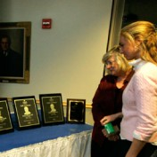 Whitney Earle surveys the Honor plaques
