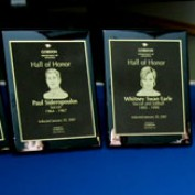The honor plaques assembled on a table