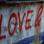 Thumbnail of Love and Revolution spraypainted on a wall