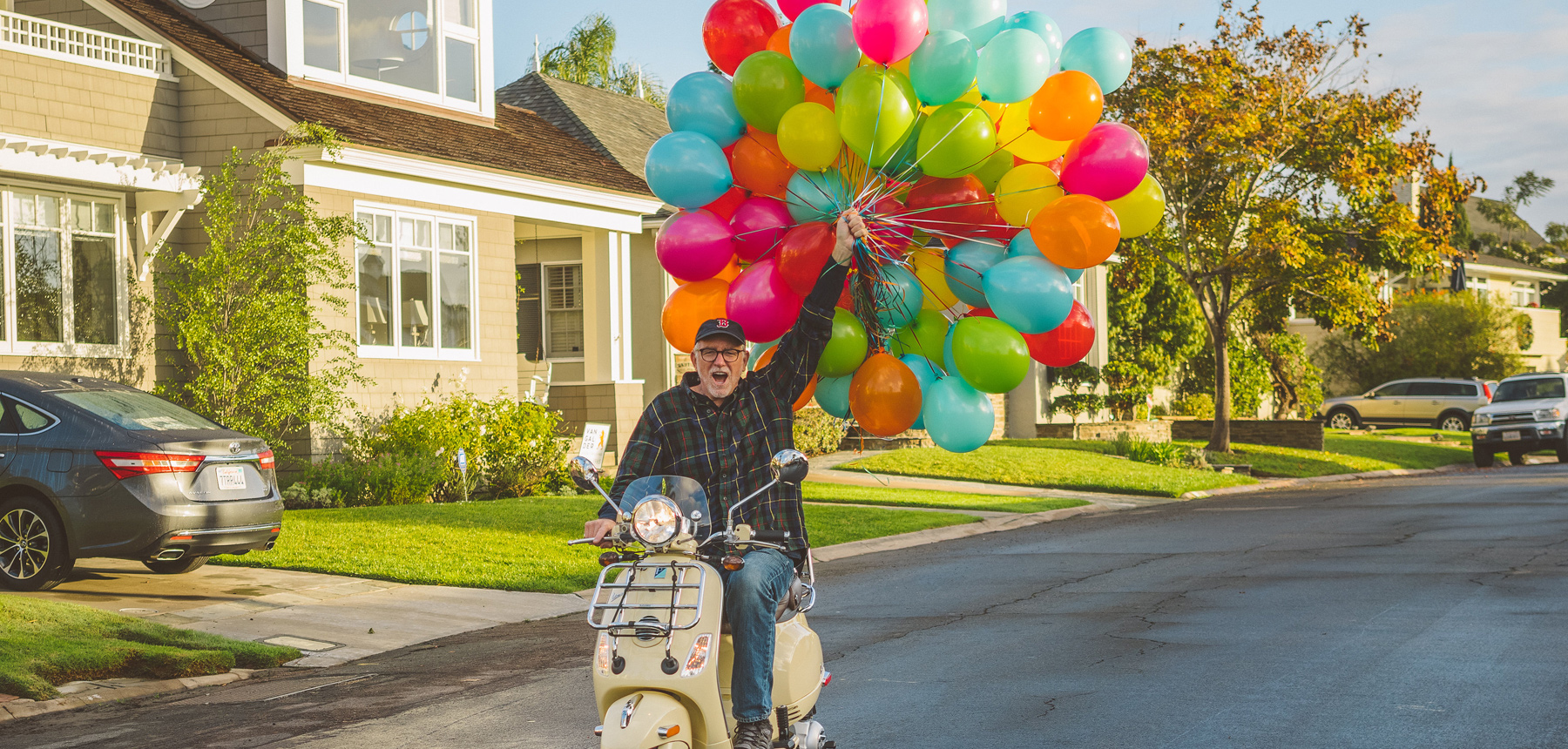 Bob Goff on Scooter with Balloons