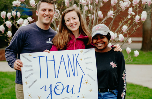 students with a thank you sign