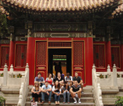 group photo by Chinese building