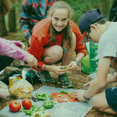 Teenager prepping camp food