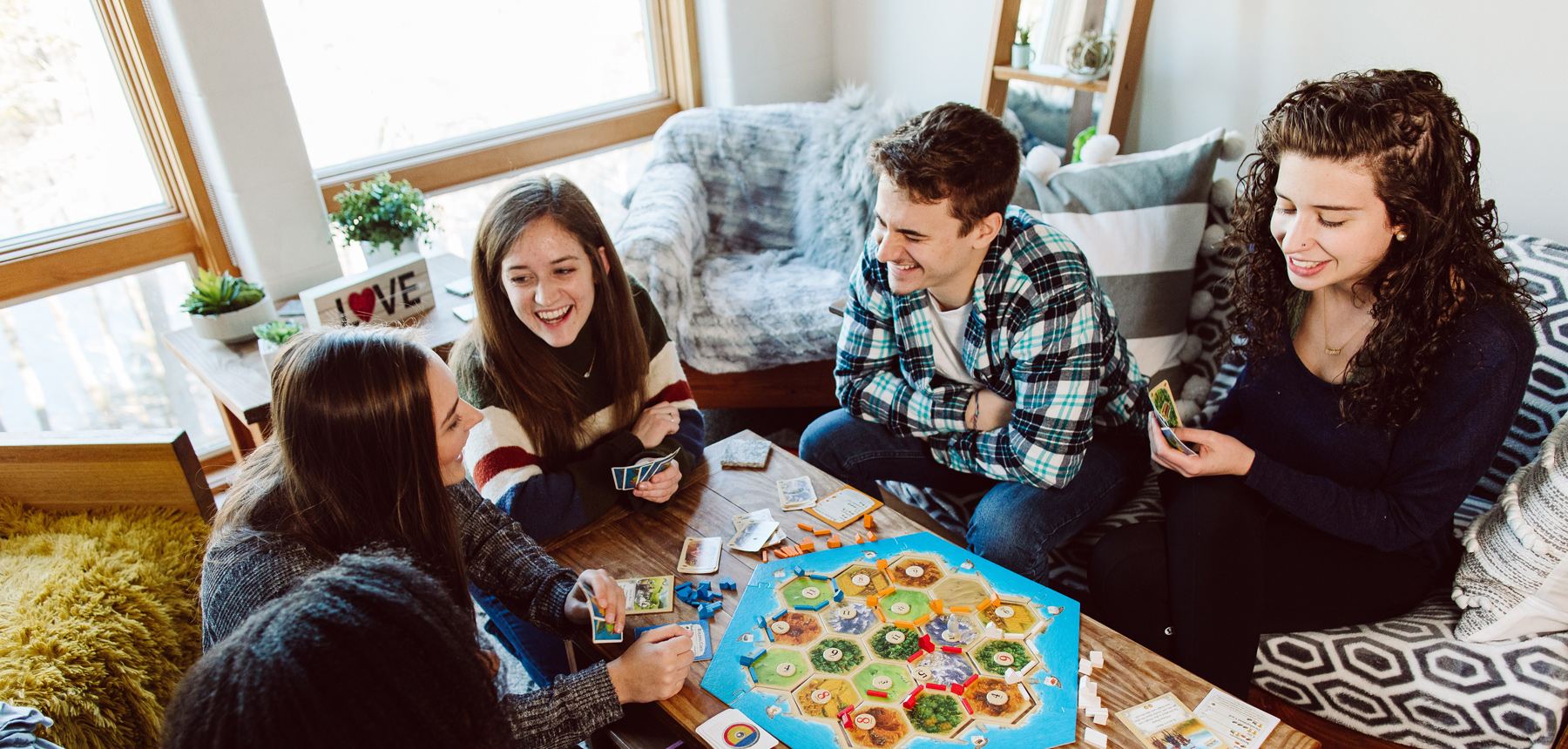 students playing boardgame