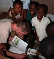 Bryn Gillette with Haitian children