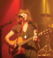 Meg Lynch performing onstage
